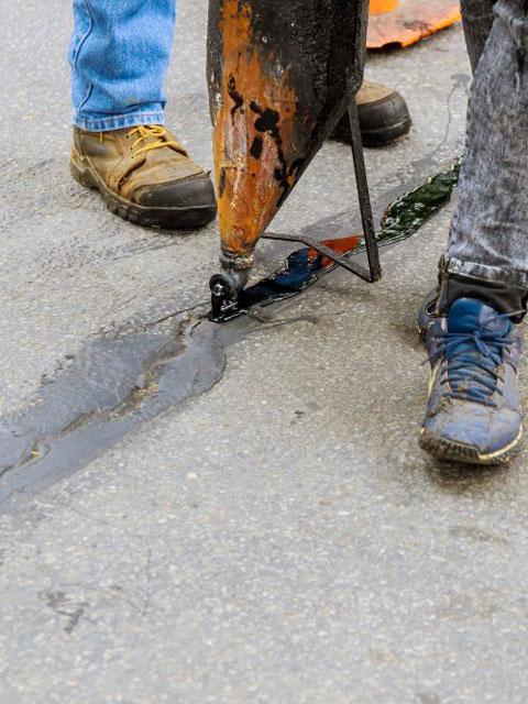 driveway repair along asphalt crack